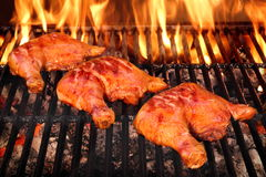 Three Chicken Leg Quarter Roasted On Hot BBQ Flaming Grill Stock Photography