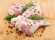 Three chicken legs sprinkled pepper on bamboo board Stock Image
