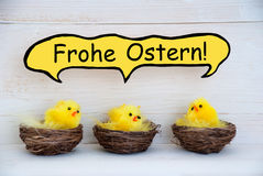 Three Chicks With Comic Speech Balloon German Frohe Ostern Means Happy Easter Stock Photo