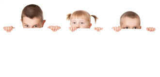 Three child behind white board Stock Image
