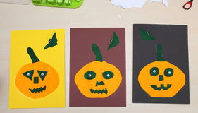 Three child made pumpkins textile on the paper Stock Photography