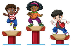 Three children on balance beam Stock Photos