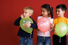 Three children with balloons royalty free stock image