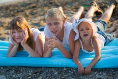 Three children on the beach royalty free stock images