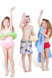 Three children in beach suits with beach accessories Stock Photo
