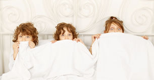 Three children in the bed Stock Photo
