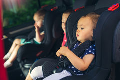 Three children in car safety seat Royalty Free Stock Image