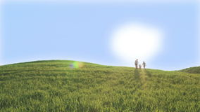 Three children are climbing on the green hill. Sunny spring day.
