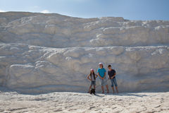 Three children with dog on background limestone wall of Pamukkale Royalty Free Stock Image