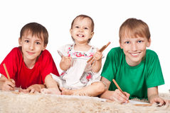 Three children drawing Stock Photos