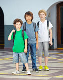 Three children in elementary school Stock Image