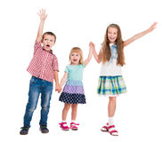 Three children with hands up Stock Photos