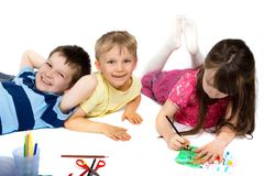 Three Children Happily Drawing stock images