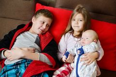 Three children at home Stock Image