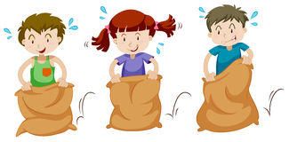 Three children jumping in sacks Stock Images