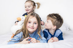 Three children, kids, boy and girls, playing  in Stock Images
