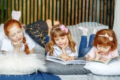 Three children lie and read books. The concept of lifestyle, chi stock photo