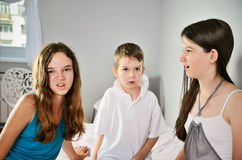 Three children look with disgust. Horizontal Royalty Free Stock Image