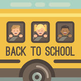 Three children looking out the windows of a school bus. Three children looking out the windows of a yellow school bus, two boys and a girl. Back to school Royalty Free Stock Photography