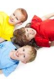 Three children lying Stock Photos