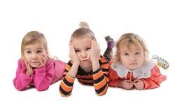 Three children lying Stock Image
