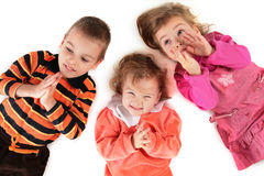 Three children lying top view close-up Stock Photo