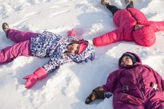 Three angels on the snow Stock Images