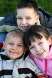 Three Children In The Meadow Stock Photos