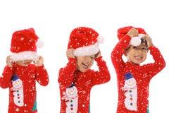 Three children Merry Christmas Stock Images