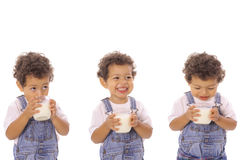 Three children with milk Royalty Free Stock Image