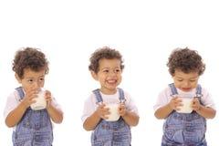 Three children with milk Royalty Free Stock Image