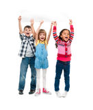 Three children with open mouths holding empty sheet of paper. Isolated on white background Stock Photo
