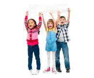 Three children with open mouths holding empty sheet of paper. Isolated on white background Stock Photos