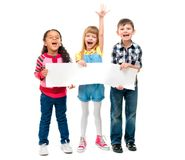 Three children with open mouths holding empty sheet of paper. Isolated on white background Royalty Free Stock Photo