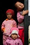 Three children peeping Stock Photography