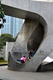 Three children play on large metal sculpture Shanghai China Royalty Free Stock Images