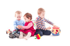 Three children play Royalty Free Stock Image