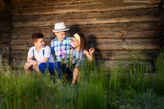 Three children played together in the summer. Brother and sister portrait in the village royalty free stock photo