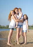 Three children playing on beach Royalty Free Stock Images