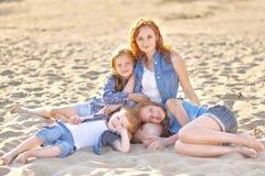 Three children playing on beach Royalty Free Stock Photo