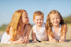 Three children playing on beach Royalty Free Stock Photography