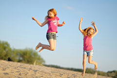 Three children playing on beach Stock Photography