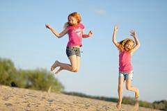 Three children playing on beach Stock Photography