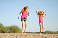 Three children playing on beach Royalty Free Stock Photos