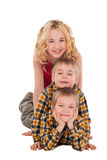 Three children playing on the floor with each other Stock Images