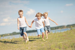 Three children playing Royalty Free Stock Image