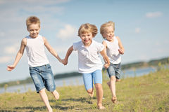 Three children playing Stock Photo
