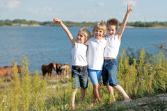 Three children playing Stock Images