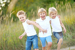 Three children playing Stock Photos