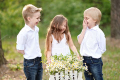 Three children playing on meadow Royalty Free Stock Photos